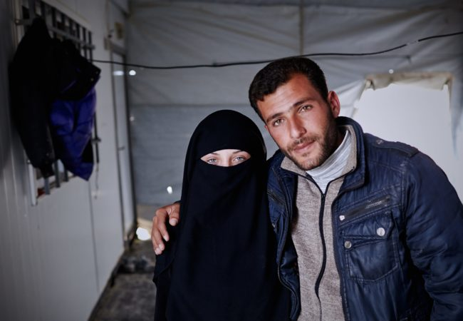 Syrian refugees Amaneh Abdel Hamid Al Nasser, 16, and Ahmad Jamal Abo Sallo'o, 23, pose for a photograph in Zaatari refugee camp located 10 km east of Mafraq, Jordan. They married last year in a ceremony that they both call the best day of their lives. (Photo by Shawn Baldwin/UNHCR)