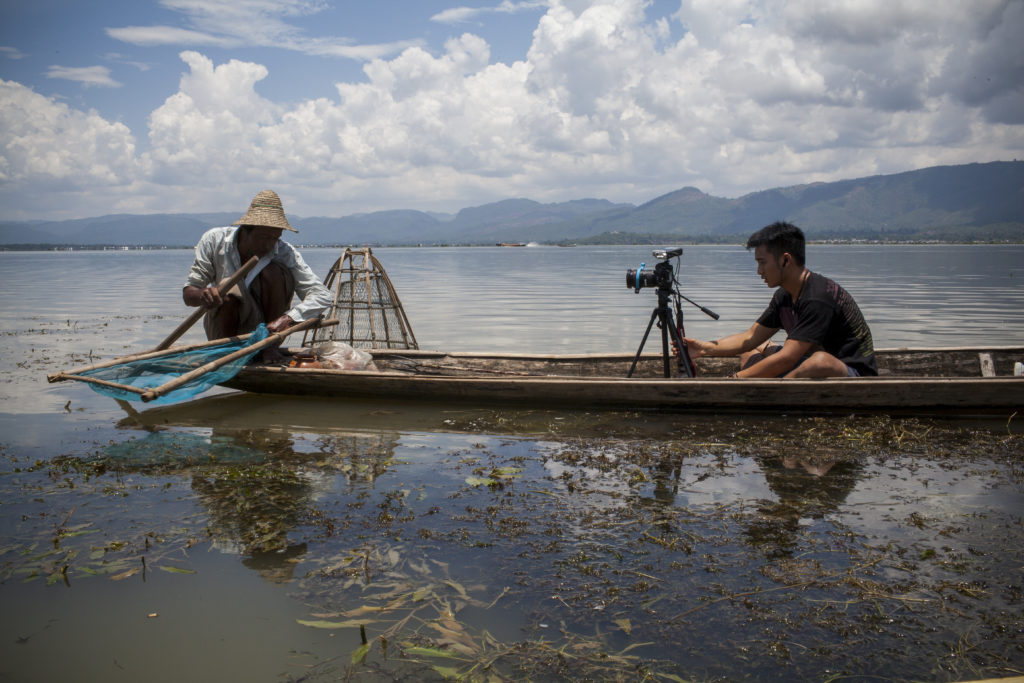 GroundTruth Fellow Johnny Wu photographs a fisherman on a boat in Inle Lake, Southern Shan State, Myanmar. (Natalie Keyssar/GroundTruth)