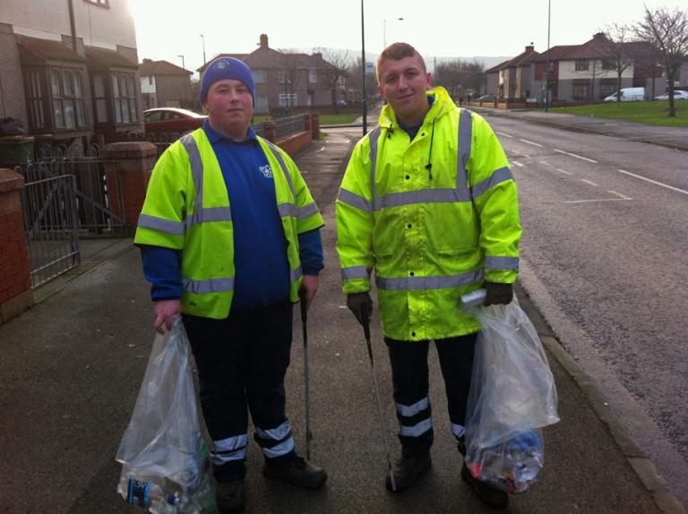 "James Bradley and Jonathan Hudson cleaning the streets of Grangetown, Middlesbrough. Council workers such as these cleaners are called ""Clean and Green"" teams. (Seamus Murphy/VII/GlobalPost)"