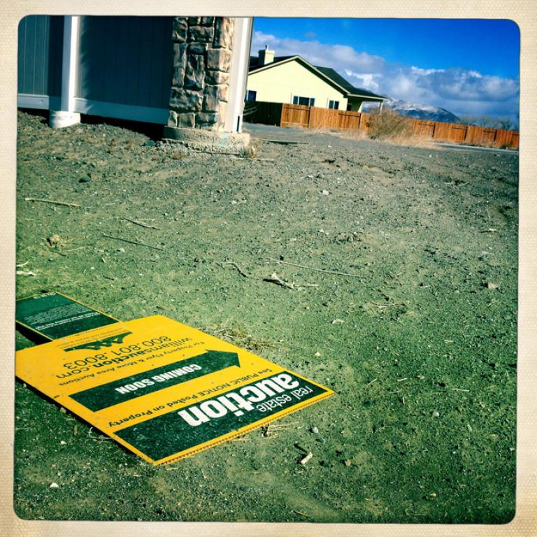 A fallen home auction sign near an unfinished housing development in Fernley, Nevada. The area flooded in 2008 after an irrigation levee broke. (Kevin Grant/GlobalPost)
