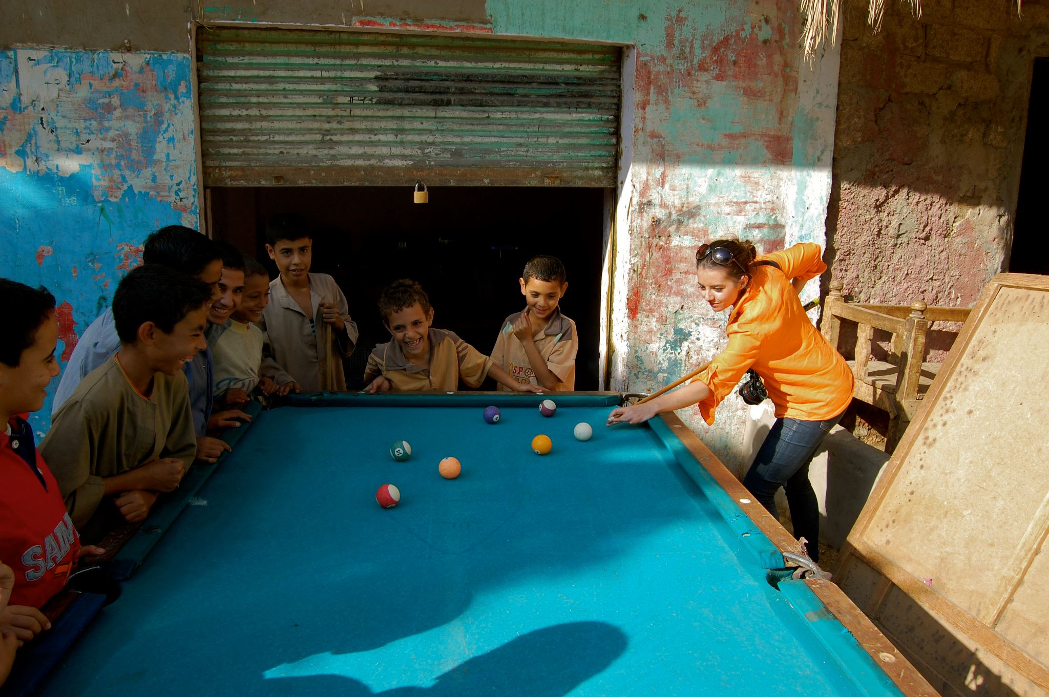 Playing pool with a group of Egyptian children in the countryside.