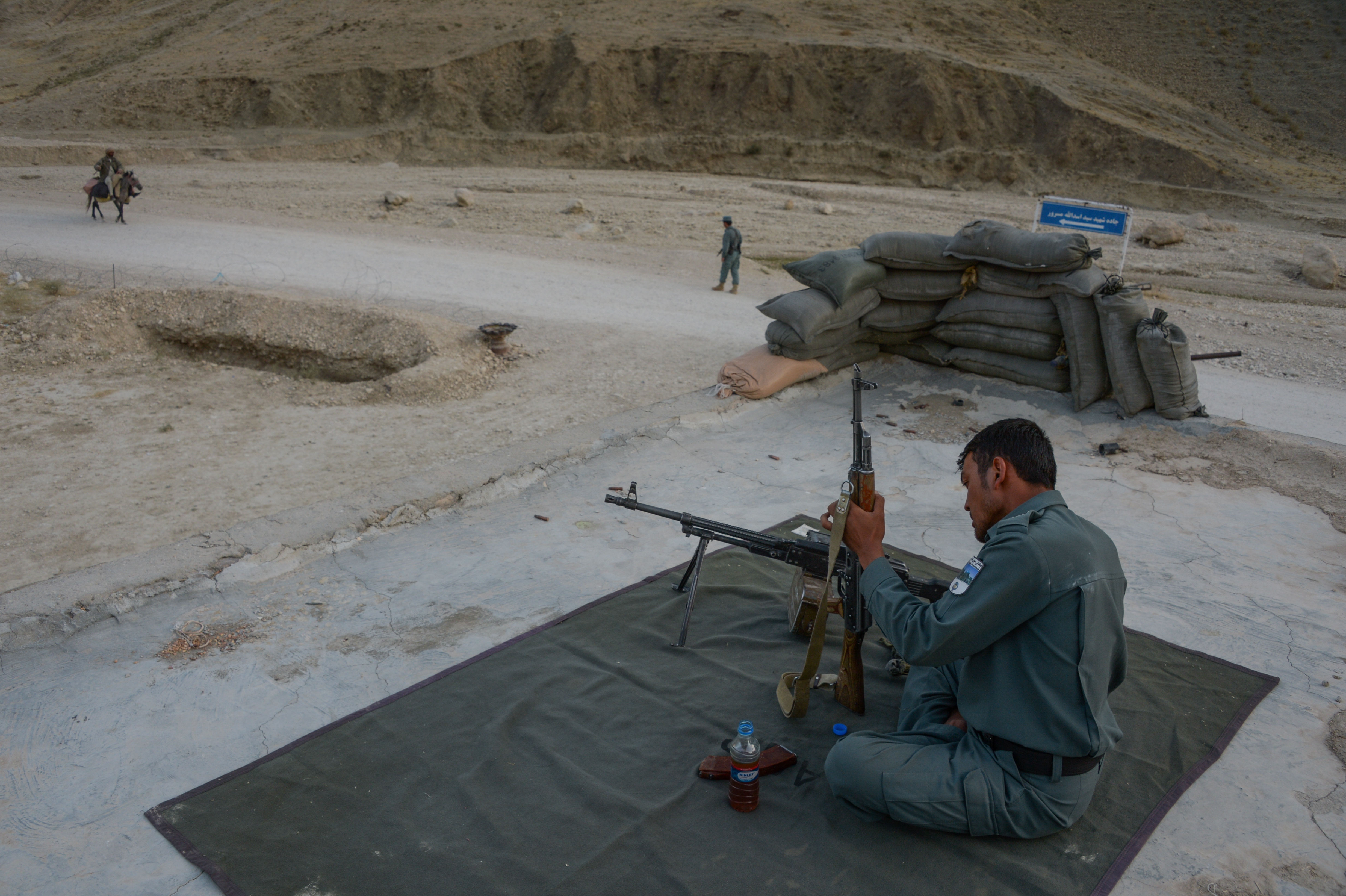 afghan police with gun