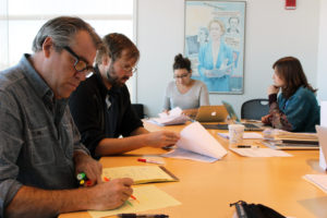 The GroundTruth team pores over applications for our inaugural climate change fellowship