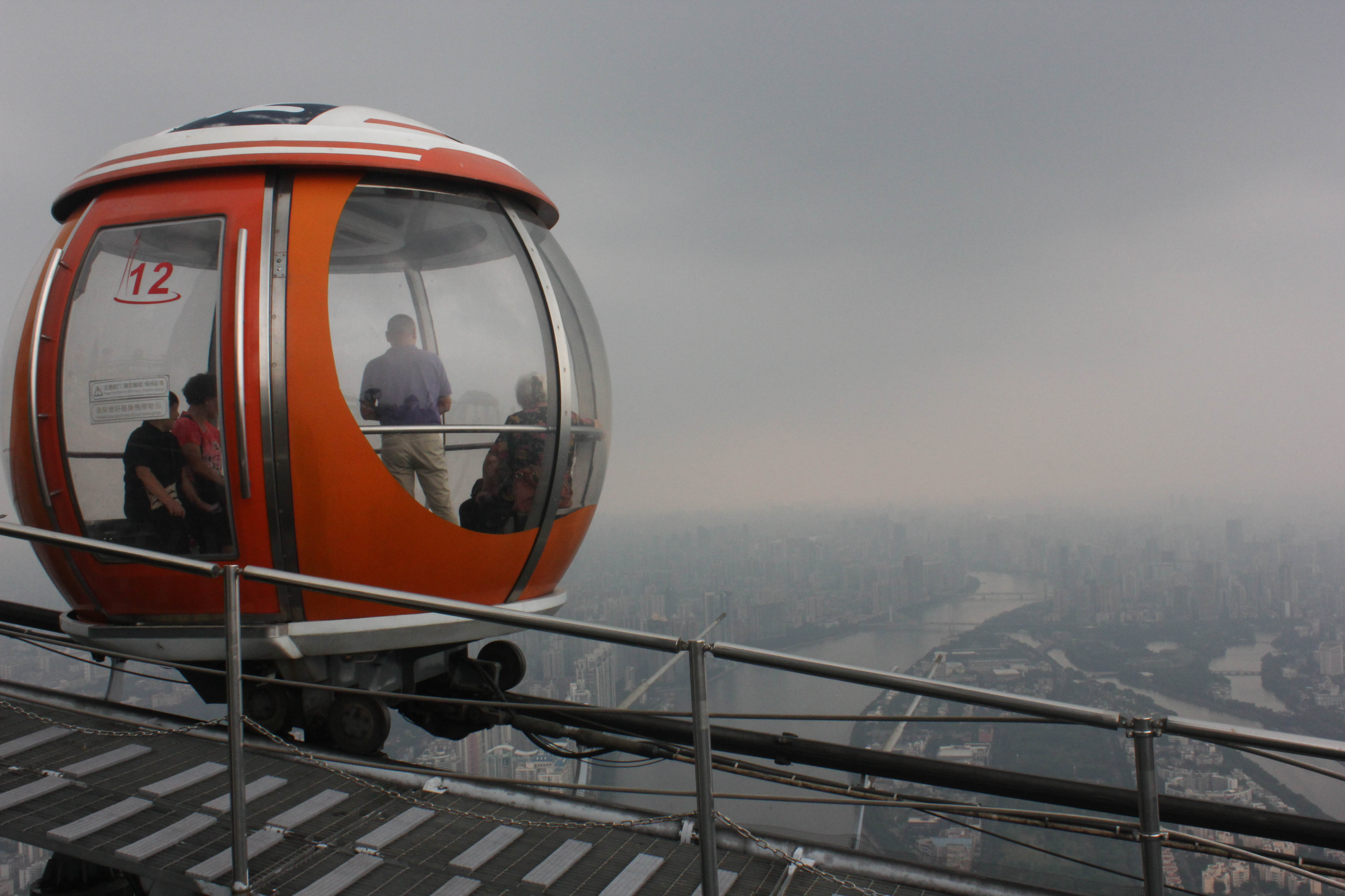 "Sight-seers get more than they paid for to ride the ferris wheel at the top of Guangzhou's Canton Tower. That afternoon on Sep. 20, the US Embassy reported Guangzhou's air was ""unhealthy for sensitive groups"" at 24-hour exposure at this level of air pollution. The embassy gives hourly updates on the city's air quality on Twitter at @Guangzhou_Air, although Twitter is blocked in China."