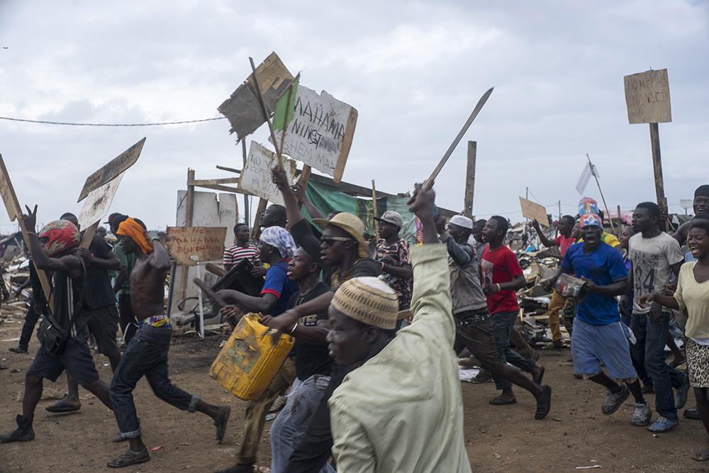 Protestors of Agbogbloshie gained momentum as they ran towards Ghanaian riot control while clashing in Agbogbloshie. Over 20,000 people were evicted from the shoulders of the Odaw River and the Korle Lagoon.