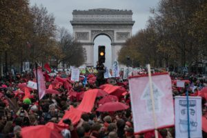 Climate justice advocates protest before the Arc de Triomphe in Paris on December 12, 2015. (Nichole Sobecki/The GroundTruth Project)
