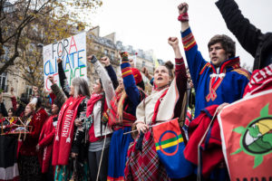 Sami activists protest for climate action in Paris on December 12, 2015. (Camilla Andersen/The GroundTruth Project)