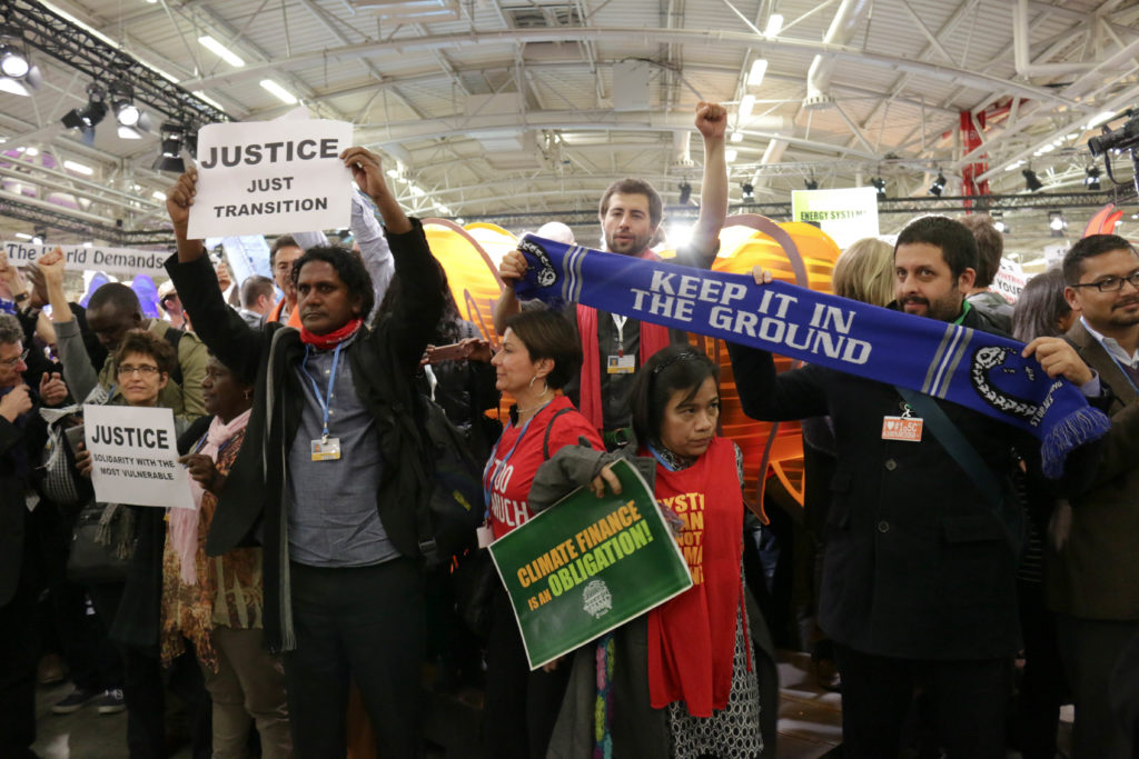 Climate advocates for youth, women, developing countries and small island nations protest the draft agreement released today. (Photo by Justine Calma/GroundTruth)