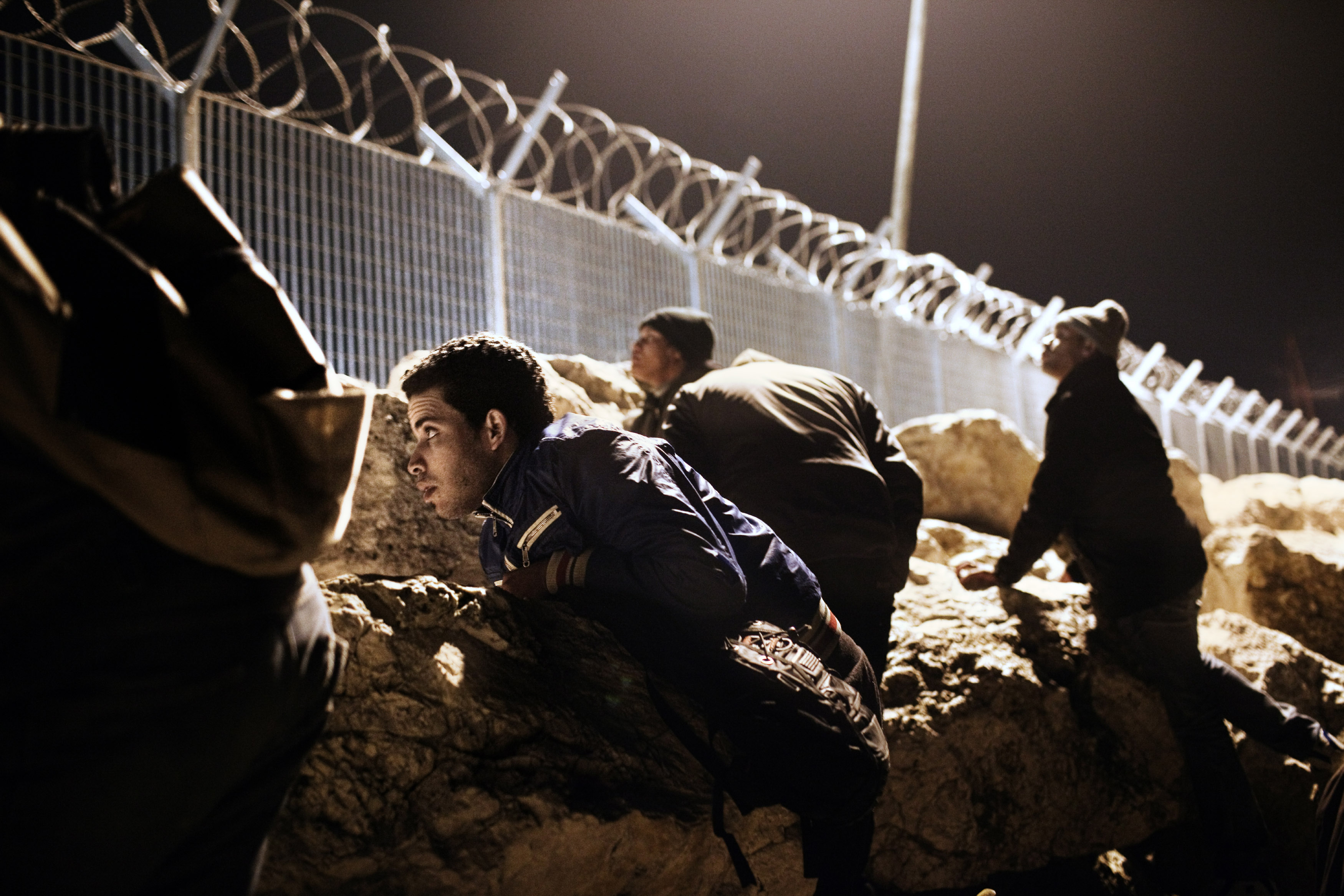 Corinth, Greece  Mohamed from Morocco and his friends hid behind the rocks at the port during the night, waiting for the right moment to illegally board a ship to Italy.