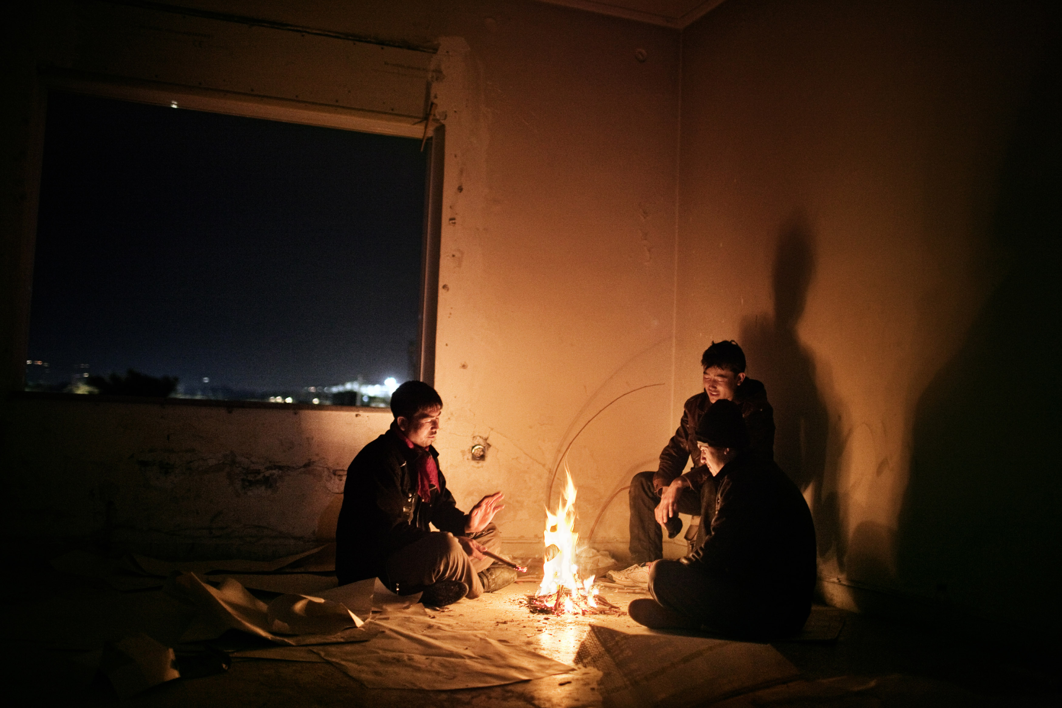 These three teenagers from Afghanistan lived in an abandoned factorynear the port of Patras. Patras Greece is one of the main escape points from Greece, due to the numerous cargo ships that dock in the port and are bound for Italy.