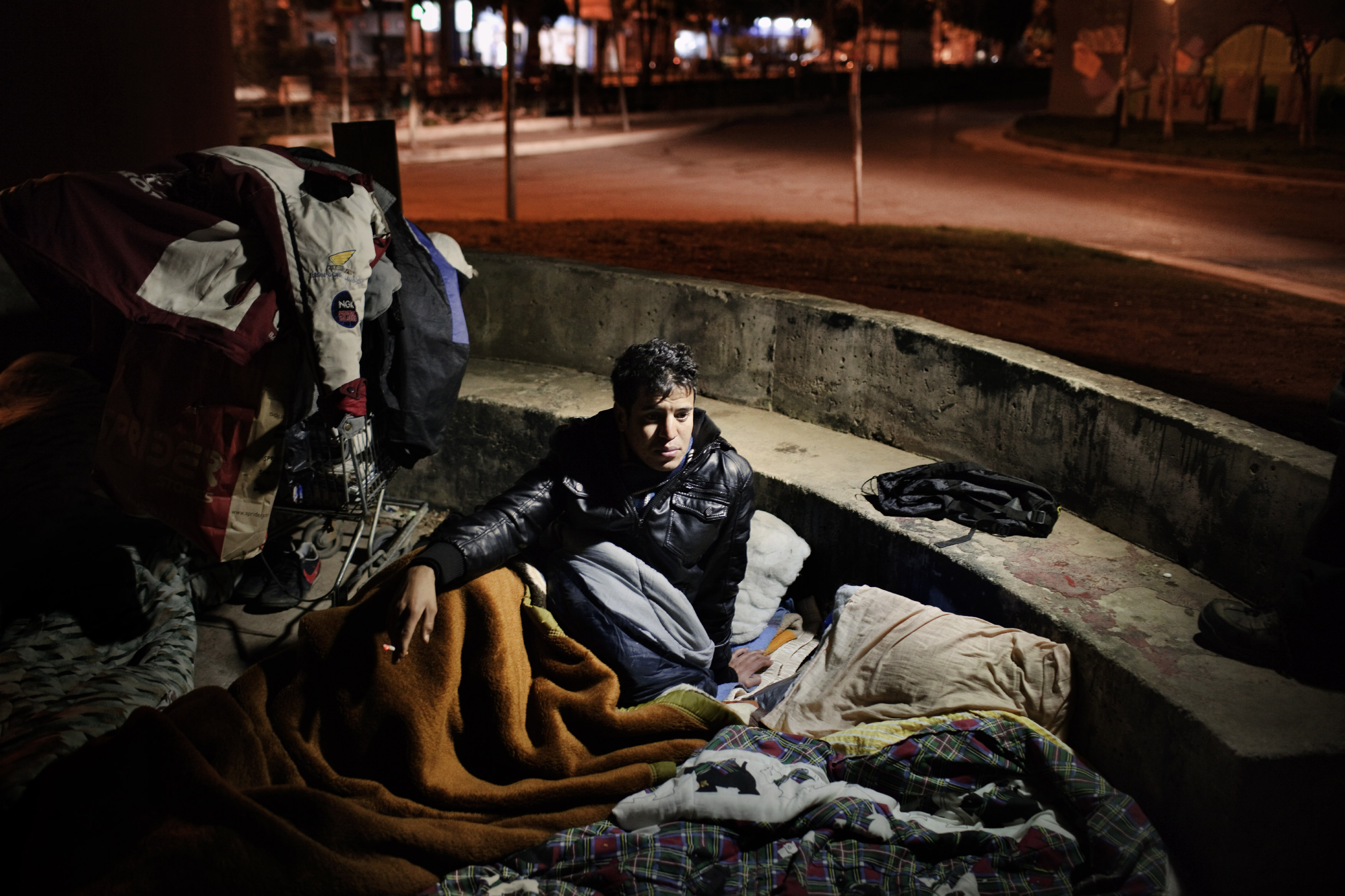 2012. Athens. Greece. A 17-year old migrant from Morocco, slept in a street near the Gazi Area. It is estimated that in 2011, migrants made up approximately 10% of the population of Greece.  Many migrants - in fact, the vast majority – are adolescents or barely over 18 – young people who have not been able to experience their youth, are left to fend for themselves on the streets they live on.