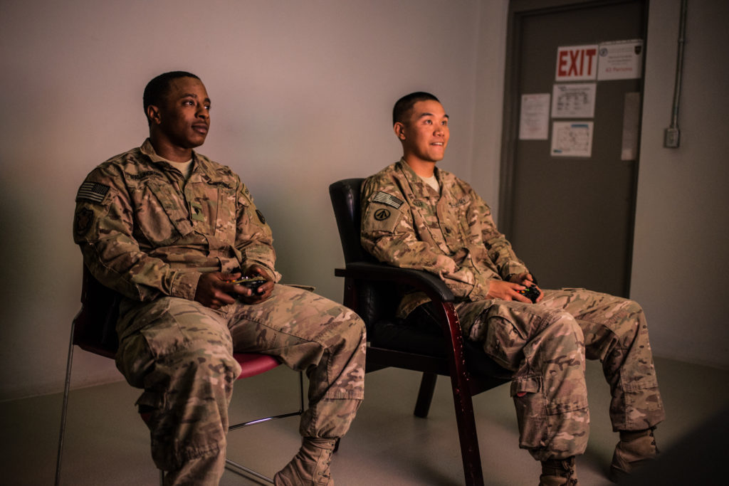 Soldiers play video games in Bagram Airfield's new recreation center. (Photo by Ben Brody)