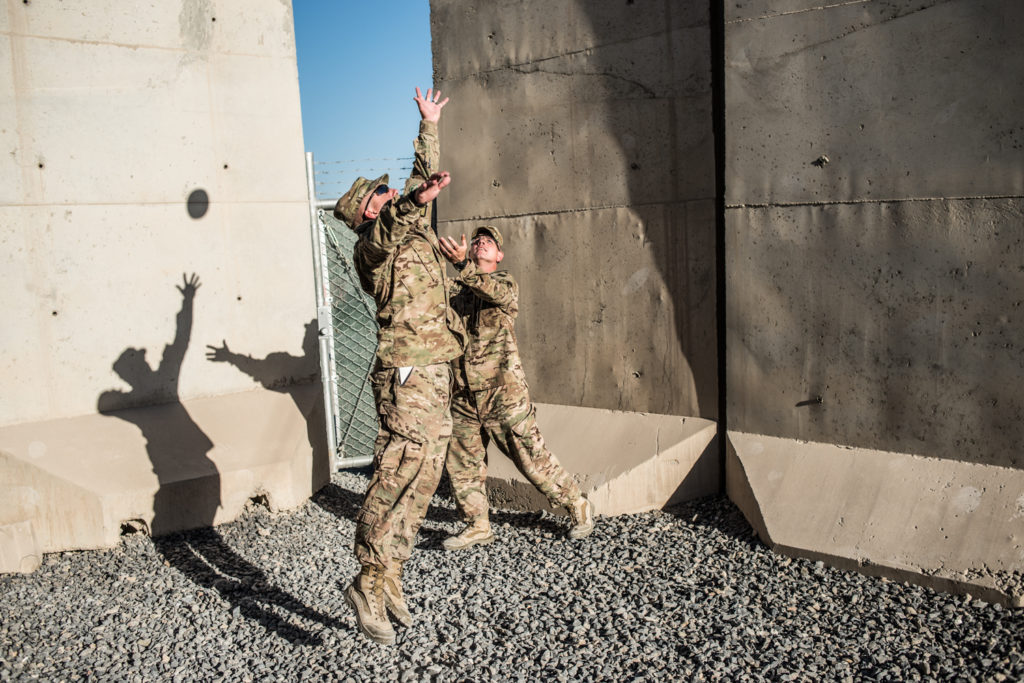 US public affairs soldiers play football within the small, fenced-in compound where reporters are billeted at Kandahar Airfield.  In 2013, reporters were not allowed to leave the billets without a military escort - before that they were given the run of the airfield. (Photo by Ben Brody)