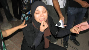 Essam Atta's sister, Hanan, grieves outside Zeinhom Morgue in Cairo, Friday, October 29, 2011.