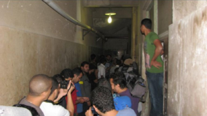 Protesters wait outside of Zeinhom Morgue for Essam Atta's body to be released in Cairo on Friday, October 28, 2011.