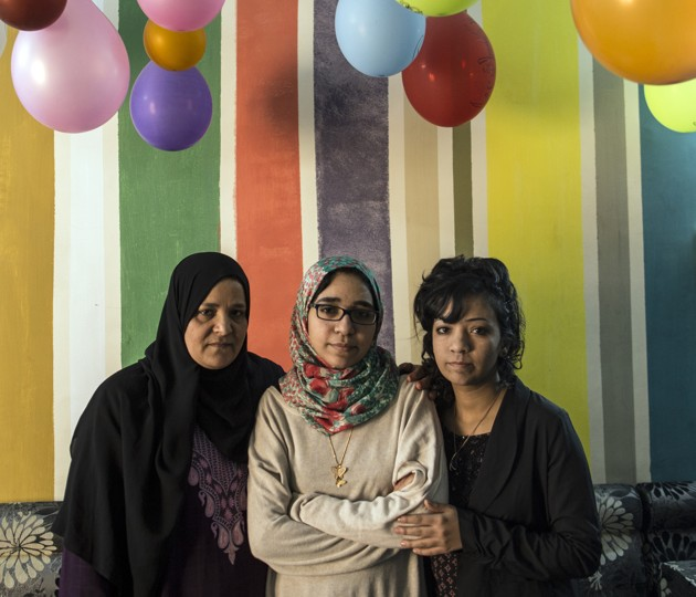 Esraa el-Taweel with her mother and sister after coming home (Photo by Roger Anis)
