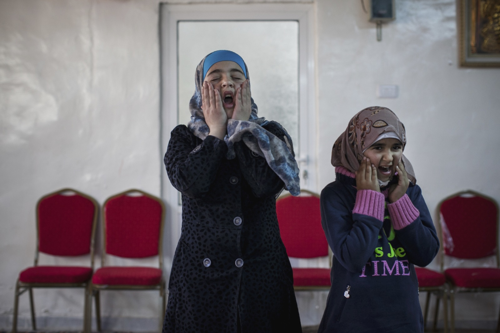 Rama (right), 12, a Syrian refugee from Daraa plays with her peers at Dar Al-Ihsan For Orphans on January 16, 2016.(Christopher Lee/GroundTruth)