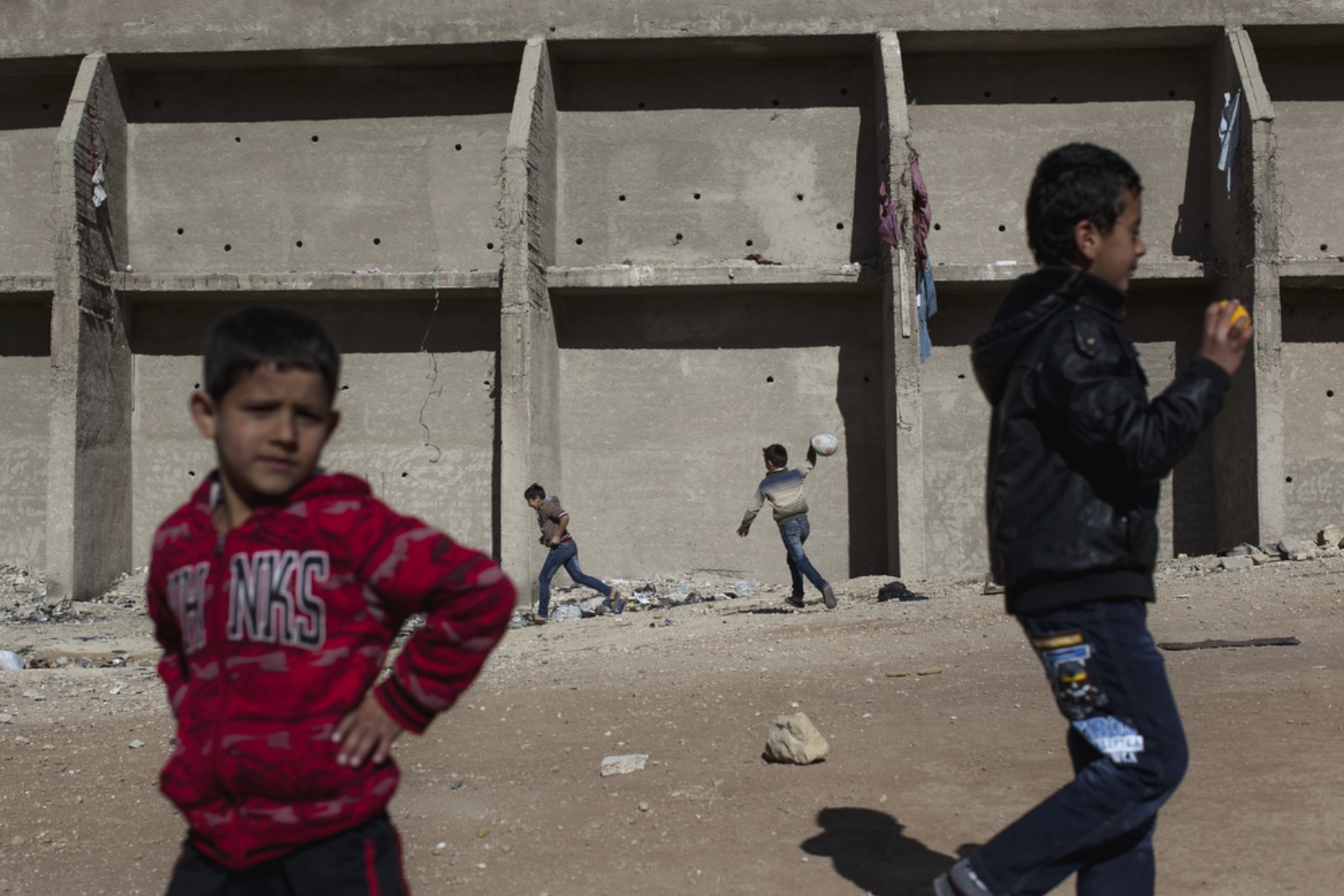 Young boys play with a soccer ball outside of Dar Al-Ihsan For Orphans (Christopher Lee/GroundTruth)