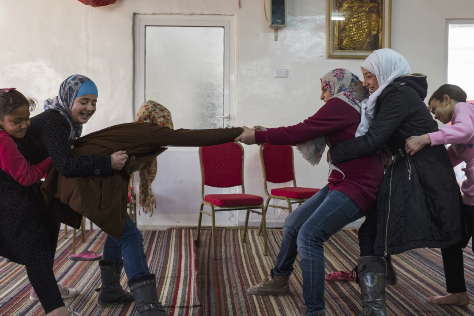 Young girls played in the community center room of Dar Al-Ihsan For Orphans on January 16, 2016. (Christopher Lee/GroundTruth)