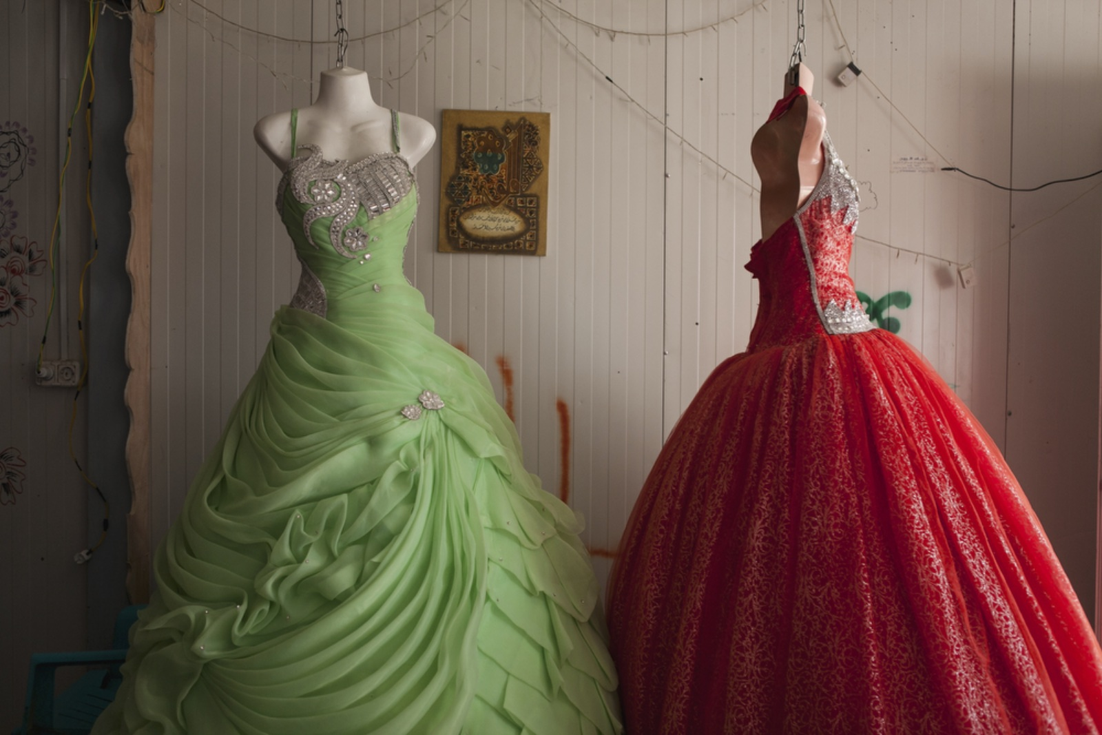 A view of a wedding dress shop in the main marketplace of Zaatari, nicknamed Champs-Elysée. The majority of the dresses are Syrian designed and made but are imported through Jordan. (Christopher Lee/GroundTruth)