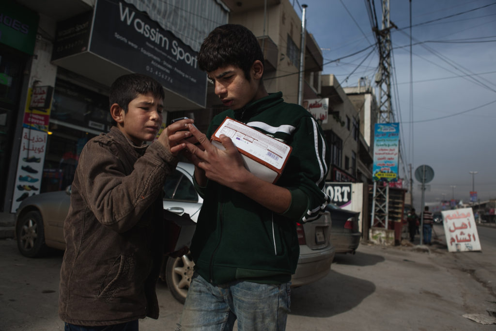 With no other way to make money, Syrian children from the Bar Elias refugee camp in Lebanon sell candy in the street.  (Photo by Christopher Lee/GroundTruth)