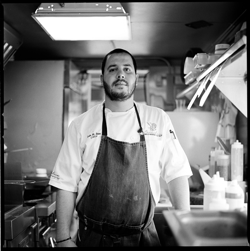 """Luis M. Diaz, 25, is an entrepreneur who started up a successful food truck called, Cosechas. It serves traditional criollo food with a modern twist. """"I studied Culinary Arts in Miami but I found life in the United States too harsh, so I ended up coming back,"""" he says. """"I wasn't doing well. In the long run, I decided to stay here because Puerto Rico has a lot of potential and you can find good local products."""" (Edwin Torres/GroundTruth)"""
