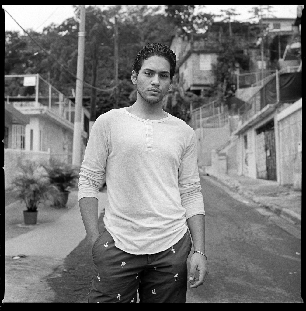 """William Valentin, 20, has overcome obstacles being from a poor barrio in Puerto Rico to go to college. He is studying education at the Metropolitan University of Cupey and Balle at the National Theater of Puerto Rico. """"In these poor neighborhoods in Puerto Rico, there is a lot of talent and intelligence,"""" he says. """"People have to push themselves forward. If they stay in the same place, they only end up in the street with money but nothing on their mind."""" (Edwin Torres/GroundTruth)"""
