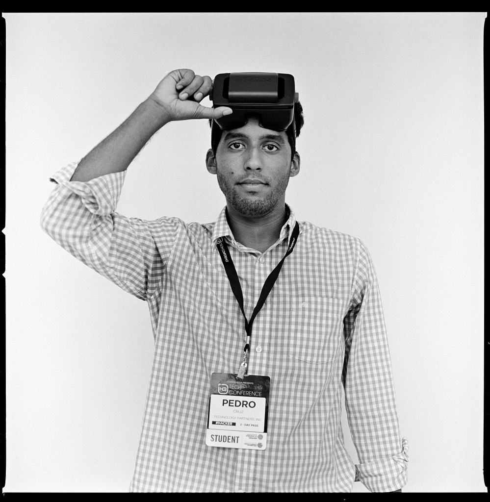 "Pedro Cruz, 21, visited the H3 conference to market a new app he is working on called Touralo.  ""Touralo lets you visualize a space without visiting it using 360 degree photography and video,"" he says. ""You put on some goggles and you're going to be able to see a house, a facility, a beach."" (Edwin Torres/GroundTruth)"
