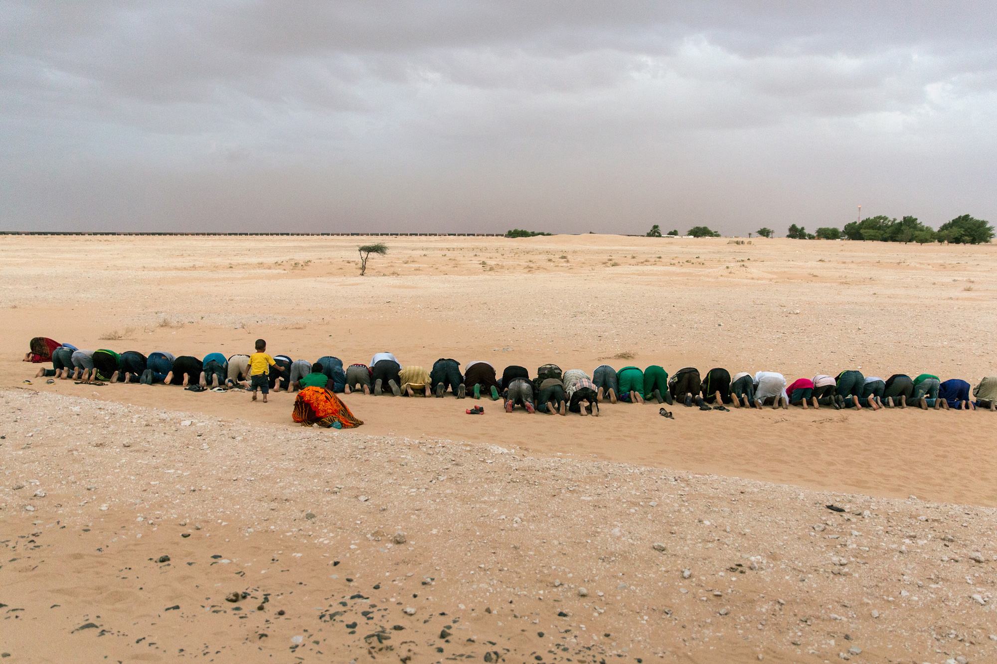 Travelers use a train stop to pray at sunset on September 29, 2015. Nearly the entire population of Mauritania is Muslim. (George Popescu/GroundTruth)