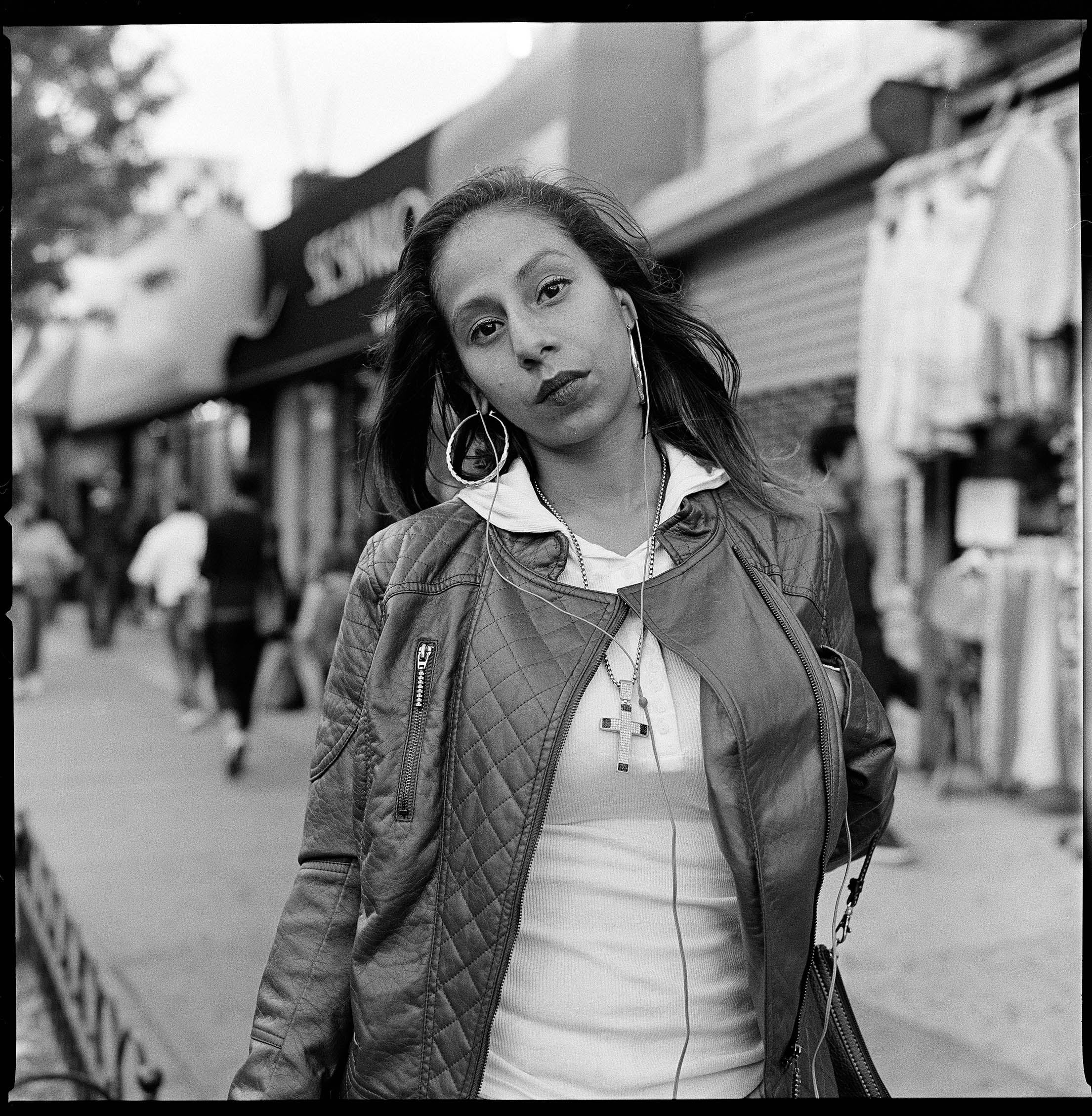 Zuly Molina, 28, on Southern Boulevard neat Hunts Point in the Bronx. After surviving domestic violence herself, Zuly decided to work as a resident assistant at a women's domestic violence shelter. (Edwin Torres/GroundTruth)