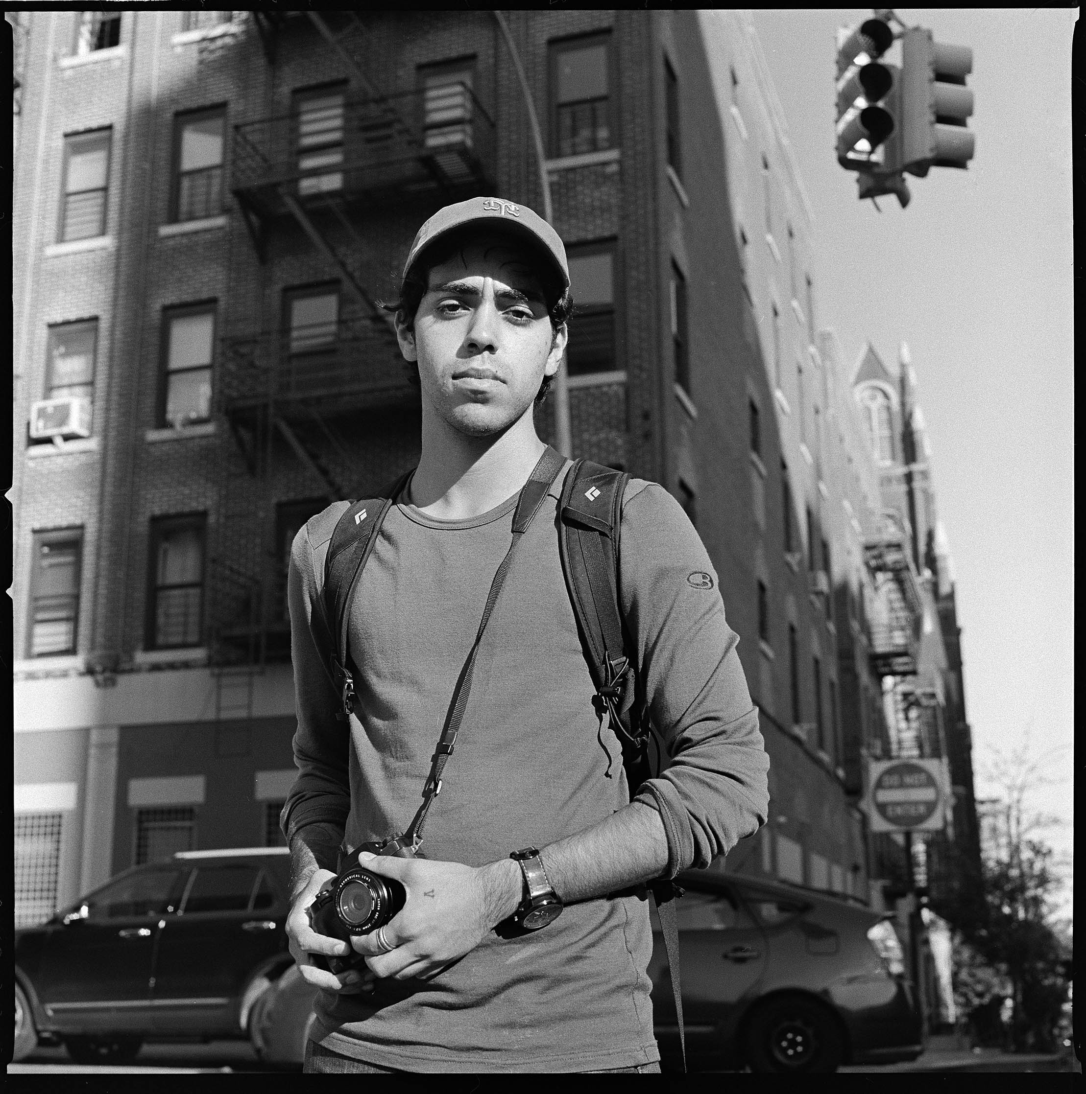 Jon Santiago, 23, dropped out of college because he couldn't afford to take out more loans. He didn't think a college degree would be critical in being a documentary photographer. (Edwin Torres/GroundTruth)