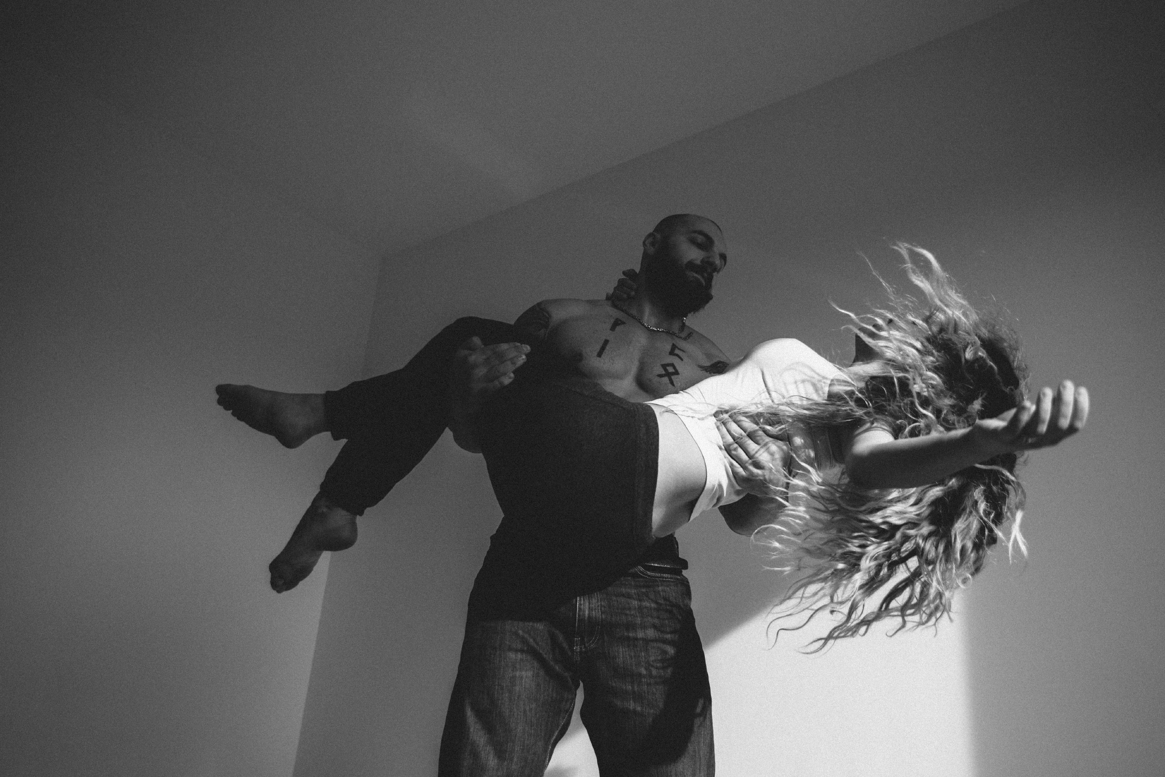 An engaged couple from Bucharest. He is stunt performer participating in different contests, and an active member of Strongman Champions League, Romania. She is also a former sport performer. (Natalia Mindru/GroundTruth)