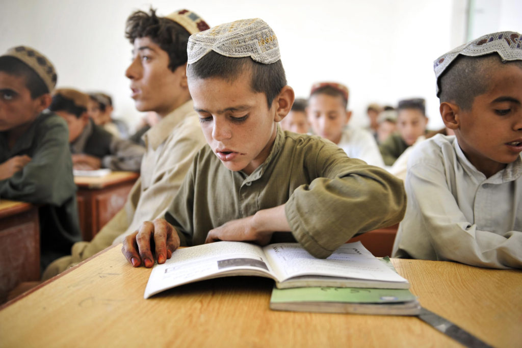 A boy attends class at a school in Nad e Ali, Helmand Province, Afghanistan. (Photo via  ResoluteSupportMedia/Flickr)
