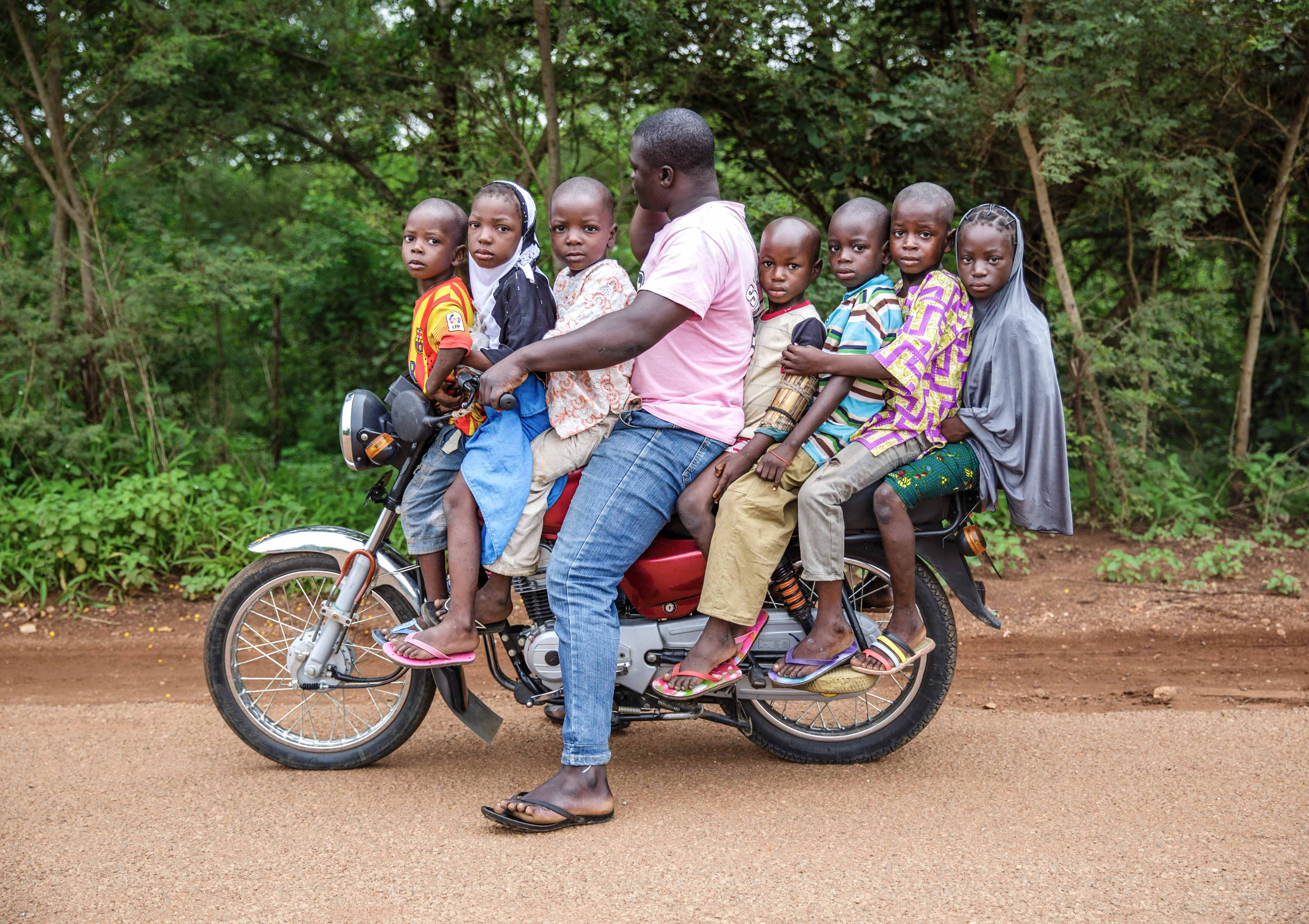 A man carrying 7 children on a motorcycle in Kwara Nigeria. (Tom Saater)