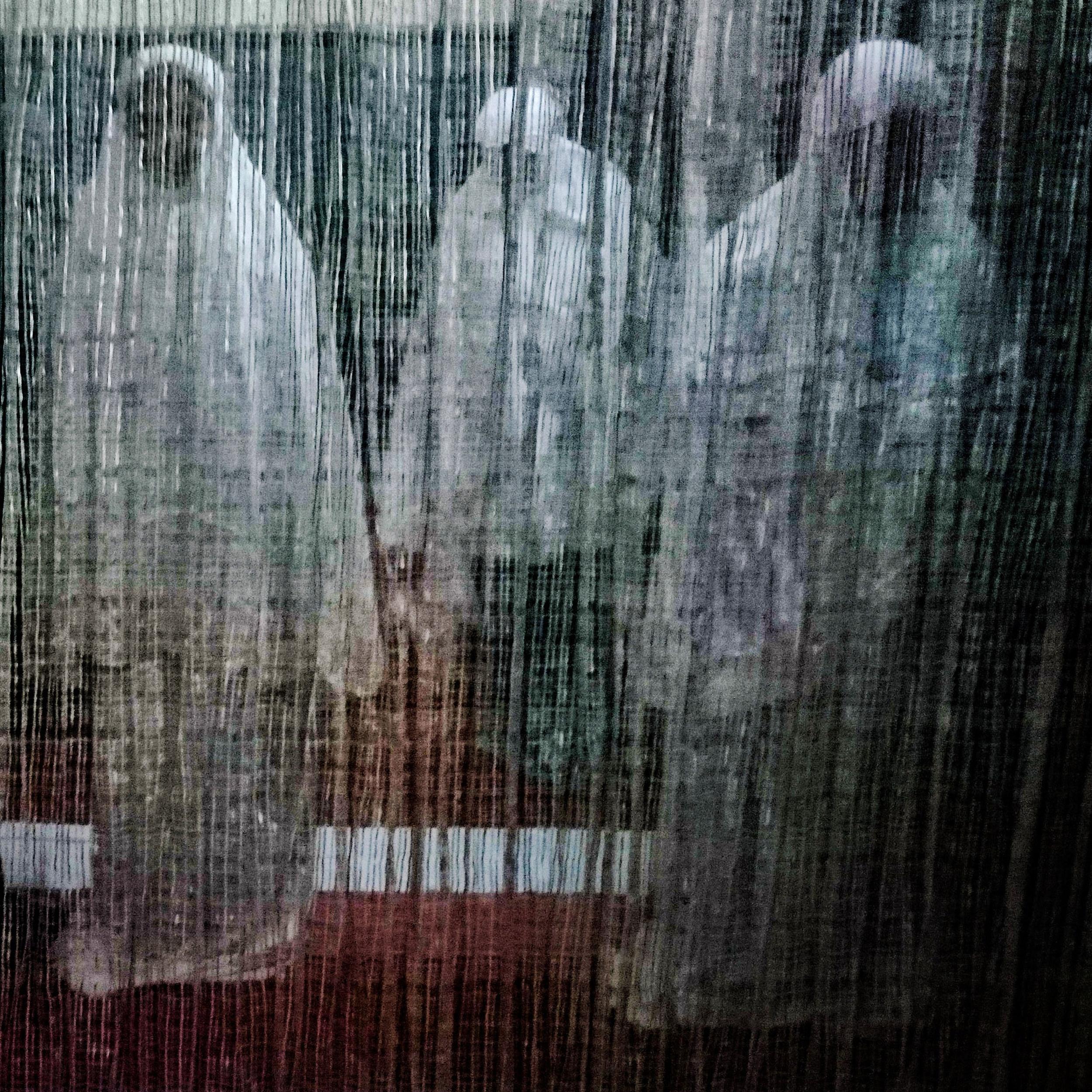 Malaysian Muslim women offering prayer behind the curtain in Kuala Lumpur, Malaysia. (Zulfadhli Zaki)