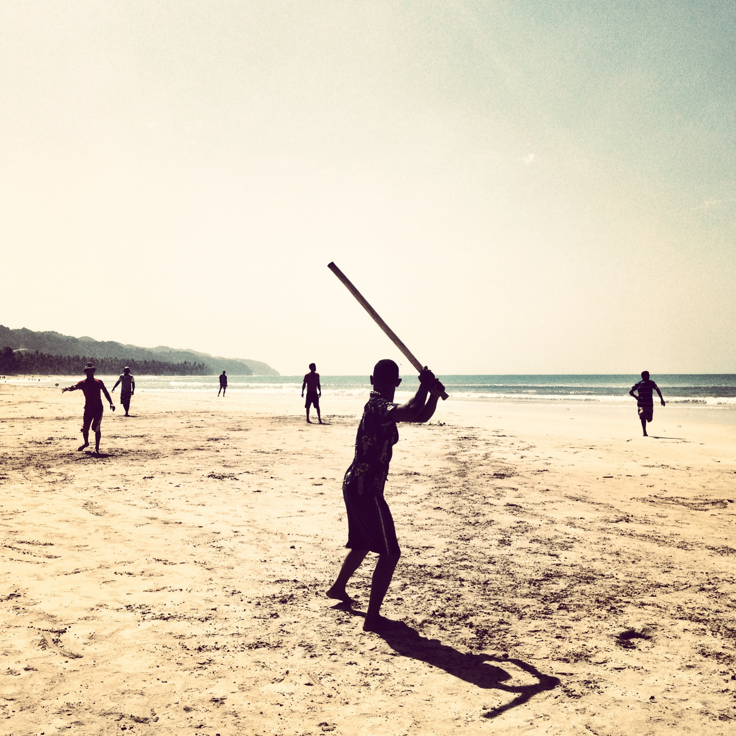 "Kids play ""vitilla"" on Coson Beach in the Dominican Republic. Vitilla is a game derived from baseball, played with sticks instead of bats and a plastic cap instead of a ball. (Tatiana Fernandez Geara)"