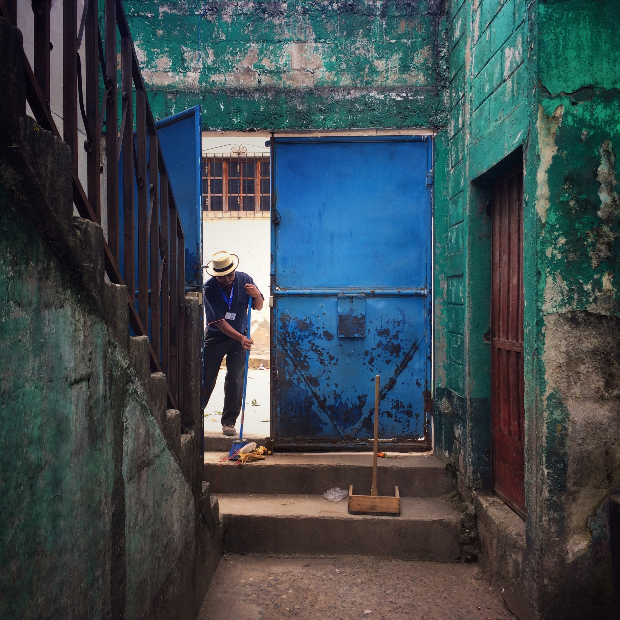 An Ixil Mayan man sweeps the entrance to a local school in Nebaj that will be used as a voting center for the Presidential elections later in the day. Nebaj, QuichŽ, Guatemala. October 24, 2015. (James Rodriguez)