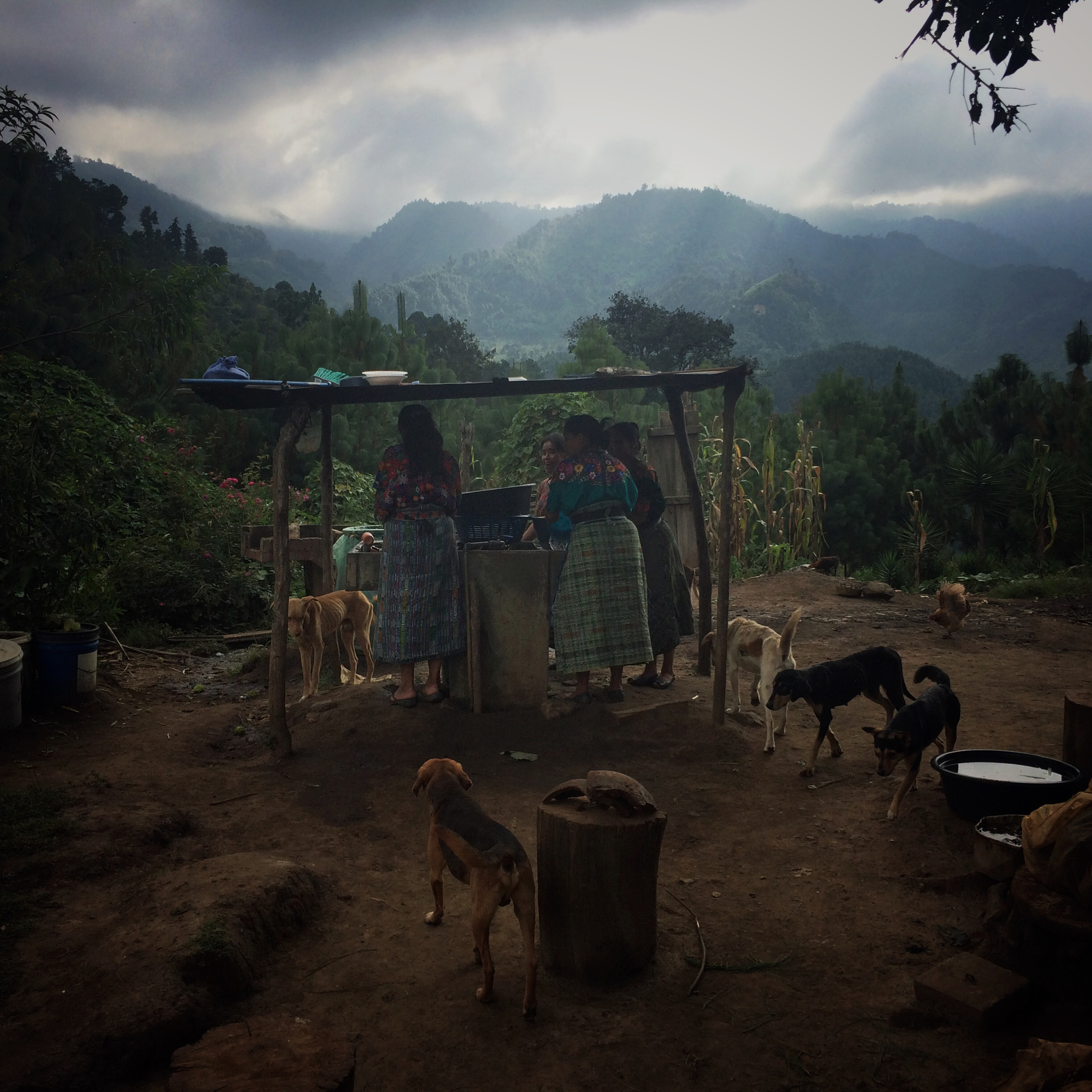 Local Kakchiquel Mayan women wash the dishes during the wake of Clementino Buc Sac. On October 28, 2015, members from the Forensic Anthropology Foundation of Guatemala (FAFG) positively identified remains of three Kakchiquel Mayans who were victims of the country's civil war, including Buc Sac's. All three victims were abducted from their homes by the Guatemalan Army on May 4, 1982. Their remains were exhumed from a common grave in Paley, San Jose Poaquil, on February 27, 2013, and positively identified through DNA technology and returned to their families. Parajbey, Santa Apolonia, Chimaltenango, Guatemala. October 28, 2015. (James Rodriguez)