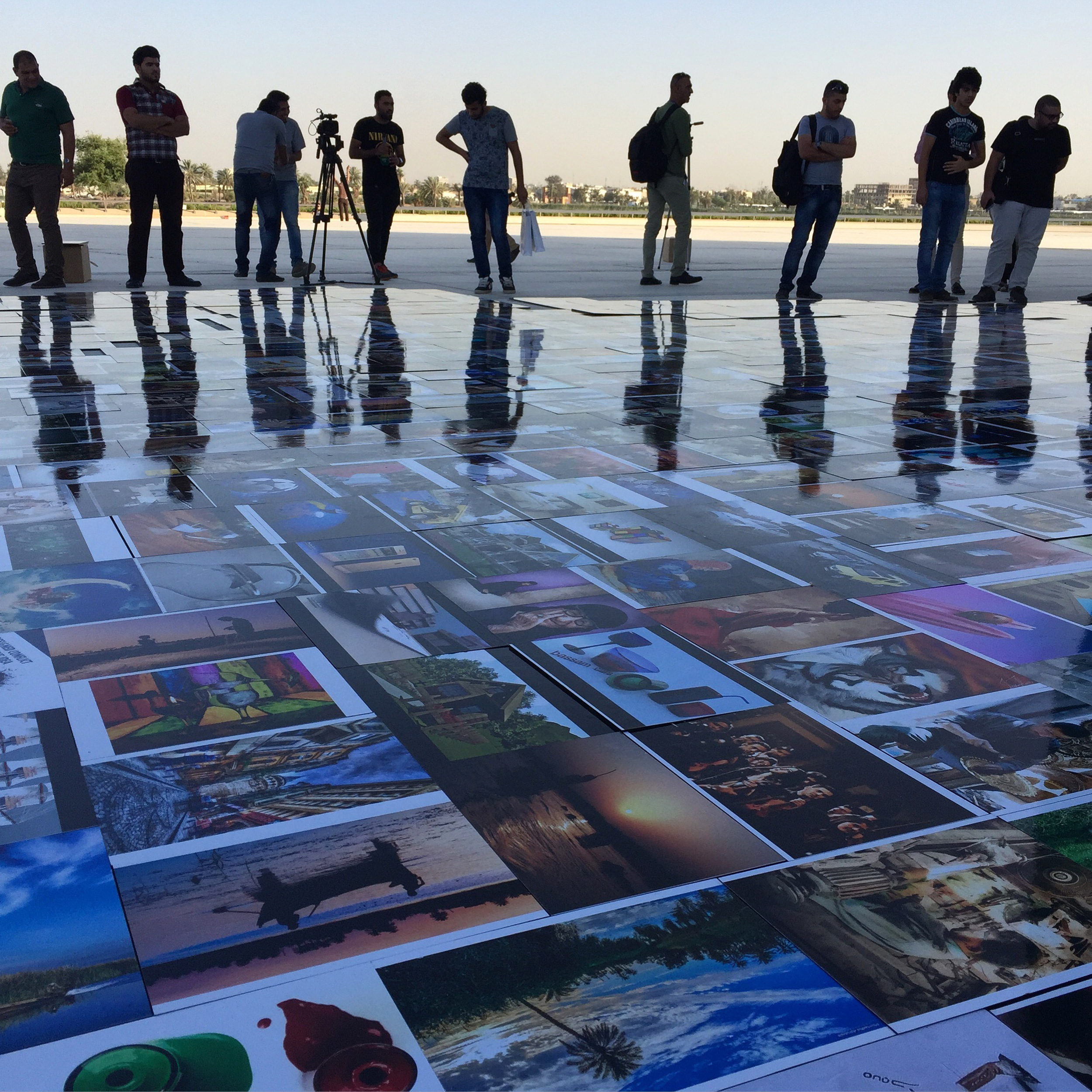 People view artworks made by young Iraqis that together form a map of Iraq at the Martyrs Monument in Baghdad, Iraq. (Ahmad Mousa)