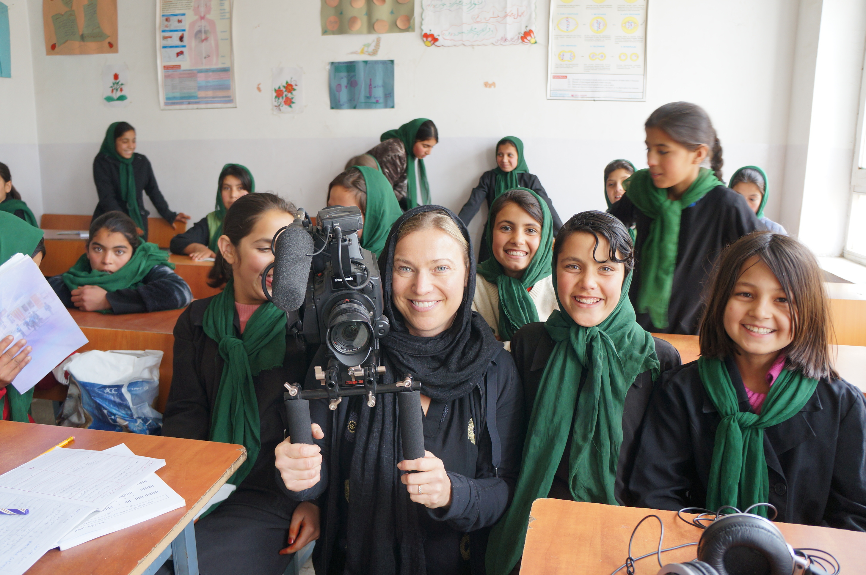 GroundTruth Films Director Beth Murphy poses with a classroom of students in Afghanistan.