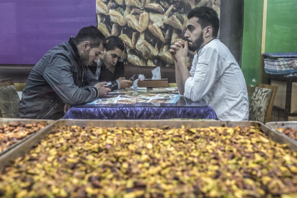 Customers eat at Salloura in Istanbul. (Photo by Joris van Gennip/GroundTruth)
