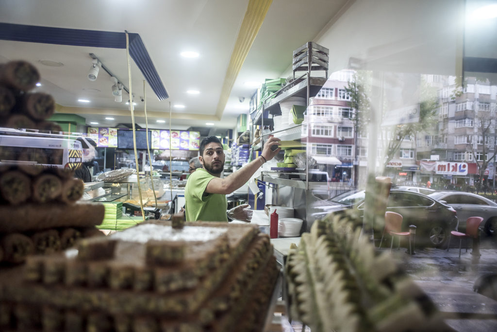 Some of Salloura's signature sweets are visible through the shop window. (Photo by Joris van Gennip/GroundTruth)