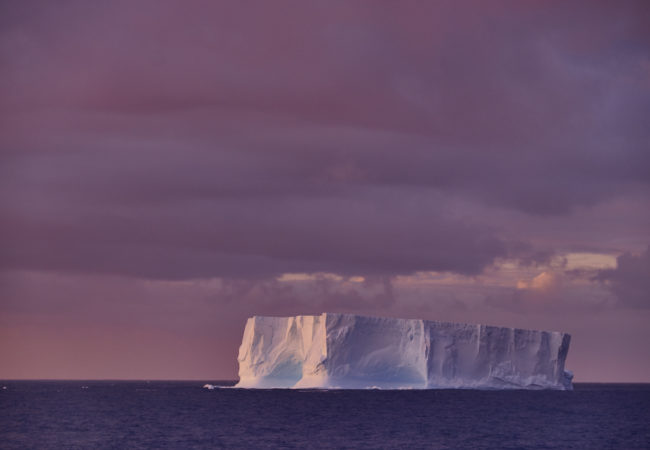 Tabular icebergs, recognizable by their cliff-like sides and flat tops, are typically taller than an apartment building and longer than a city block. (Photo by Oliver Wheeldon/2041 Foundation)
