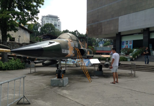 Downed U.S. military helicopters, fighter jets and tanks are on display in front of the War Remnants Museum in Ho Chi Minh City. (Photo by Joanne Silberner/GroundTruth)