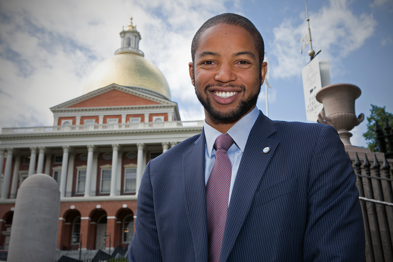 Austin Blackmon, chief of Environment, Energy and Open Space for the city of Boston, stands in front of the Massachusetts State House on June 9, 2016 in Boston. (Photo by Lauren Owens Lambert/GroundTruth)