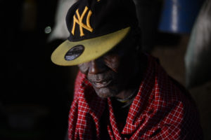"""""""In Tanzania, it is as if we don't exist,"""" says Kidomwita, 60, a Barabaig cattle herder living within SAGCOT's Kilombero crop cluster. """"It is as if this is not our country."""" Kidomwita, whose surname translates to """"Warthog"""" in Barabaig, is facing his second eviction in the last decade. After being pushed out of his home by a rice plantation in 2008, his new village of Kwa Wagonzi is being uprooted to make way for a dam that will provide irrigation for SAGCOT-backed rice and sugar farms. (Photo by Dana Ullman/GroundTruth)"""