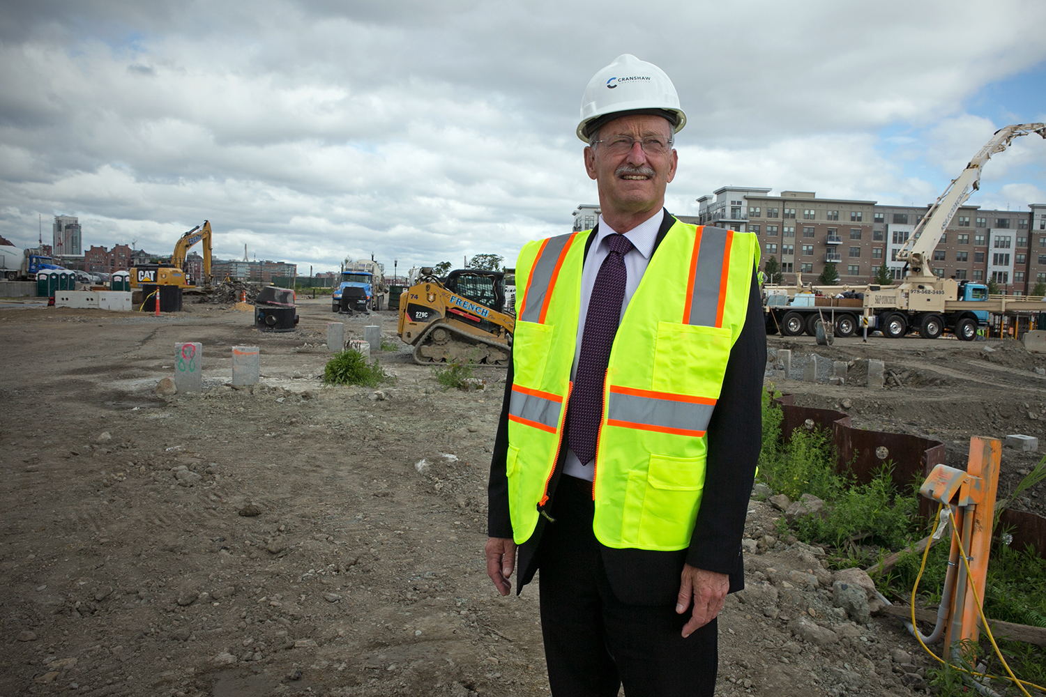 Jamie Fay, head of Fort Point Associates, stands at the construction site of Portside at East Pier, a new development in East Boston,  June 9, 2016. (Photo by Lauren Owens Lambert/GroundTruth)