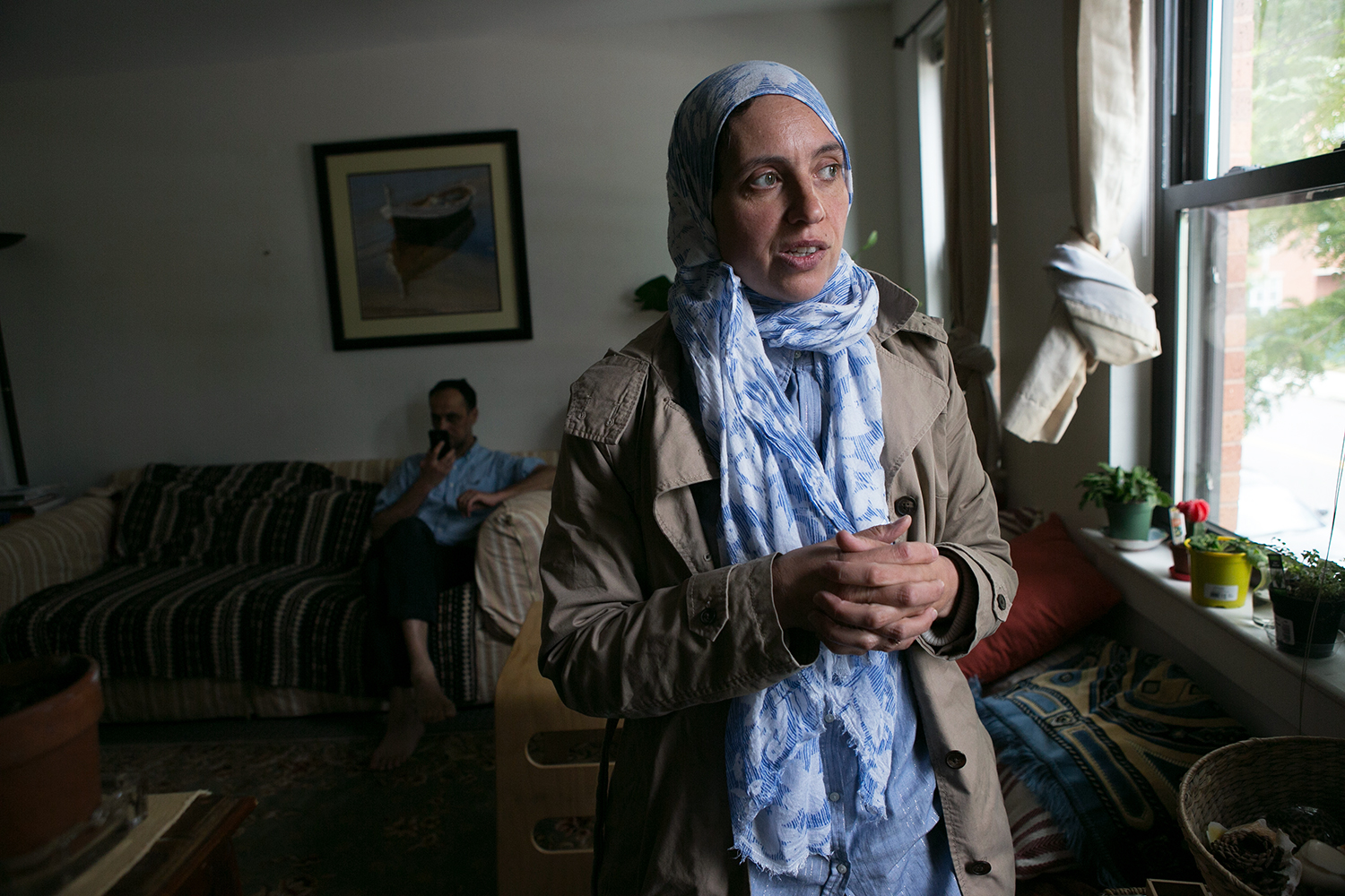 Community organizer Magdalena Ayed is pictured in her East Boston home on June 9, 2016. She says she's happy that city officials and some developers are starting to take climate change seriously. (Photo by Lauren Owens Lambert/GroundTruth)