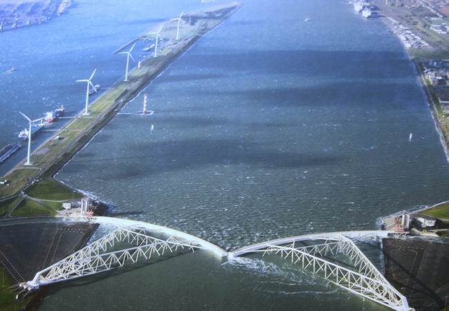 The largest mobile barrier in the world, the Maeslant storm surge barrier was built to protect the Dutch city of Rotterdam from a one-in-10,000-year storm. It's part of the massive investment the Dutch are making to protect themselves in a new era of rising sea levels. (Photo by Bert Knottenbeld/Flickr Creative Commons)