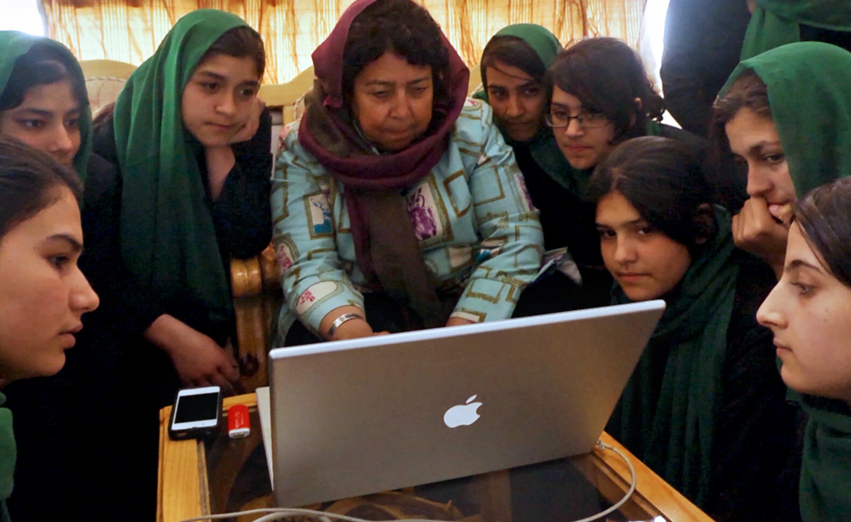 Razia Jan, the founder of a school for Afghan girls, shares photos and stories with the 9th Grade class. (Photo by Beth Murphy/GroundTruth)